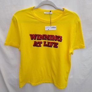Zara 'WINNING AT LIFE' cropped t-shirt.